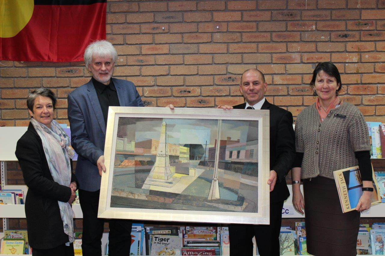 Photo Cultural Development Officer Karen Whitaker-Taylor, David Jack (son of the late artist Kenneth Jack), Baw Baw Shire Council Mayor Joe Gauci and Principal Librarian Kathie Olden standing next to the painting 'Warragul' by Kenneth Jack