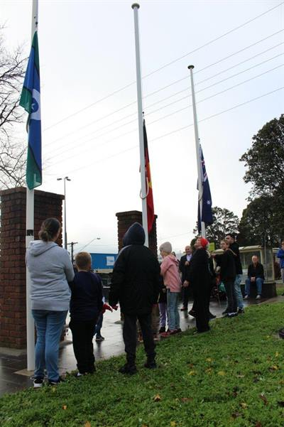 Raising the Torres Strait Islander, Aboriginal and Australian Flags in celebration of NAIDOC Week at Drouin's Memorial Park.